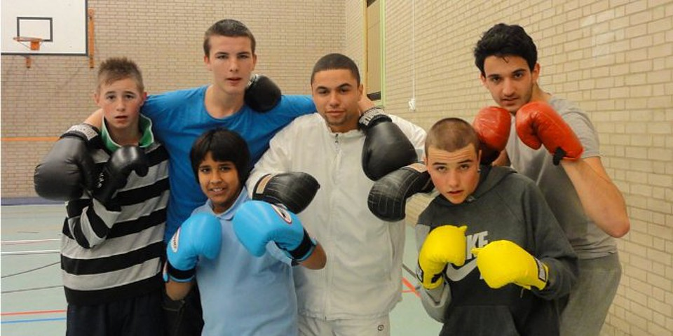 ARSP voluntary service in the UK - An ARSP volunteer with kids from his project and boxing equipment
